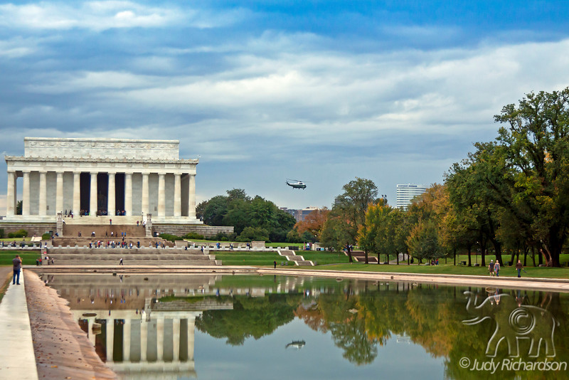 Lincoln Memorial with White House helicopter reflecting in pond after water was drained after a torrential downpour