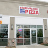 """The pizza place in Leominster """"U.S. Pizza Express"""" opened on Wednesday and they sat down to talk about their place on Friday, Nov. 22, 2019. SENTINEL & ENTERPRISE/JOHN LOVE"""