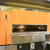 """The pizza place in Leominster """"U.S. Pizza Express"""" opened on Wednesday and they sat down to talk about their place on Friday, Nov. 22, 2019. This is their oven that cooks the pizza's. SENTINEL & ENTERPRISE/JOHN LOVE"""
