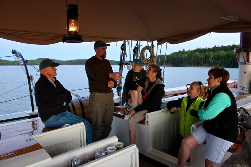 passengers of the J & E Riggin, a Maine windjammer cruise out of Rockland, Maine