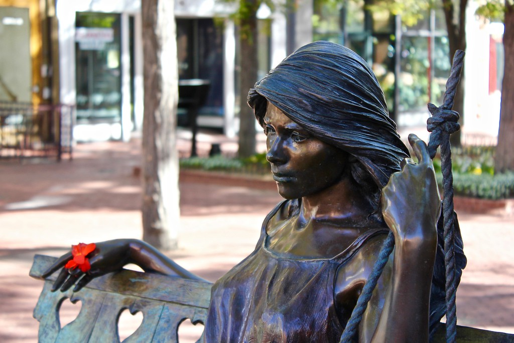 statue of woman on Pearl St. in Boulder Colorado