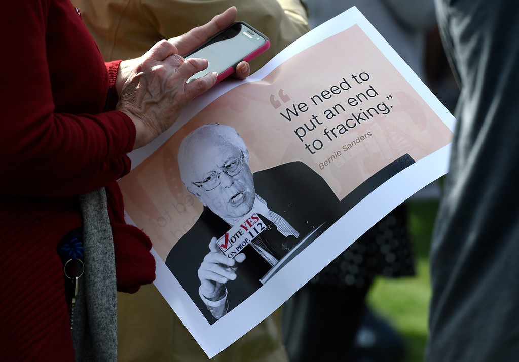 . BOULDER, CO - OCTOBER 24, 2018: A woman holds a a sign during a Democratic rally with Sen. Bernie Sanders, U.S. Rep. Jared Polis and Joe Neguse on Wednesday at the University of Colorado in Boulder. For more photos of the rally go to dailycamera.com (Photo by Jeremy Papasso/Staff Photographer)