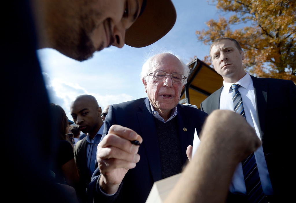 . BOULDER, CO - OCTOBER 24, 2018: Sen. Bernie Sanders signs a book for University of Colorado senior Jason Sisneros after speaking during a Democratic Rally on Wednesday at the University of Colorado in Boulder. For more photos of the rally go to dailycamera.com (Photo by Jeremy Papasso/Staff Photographer)