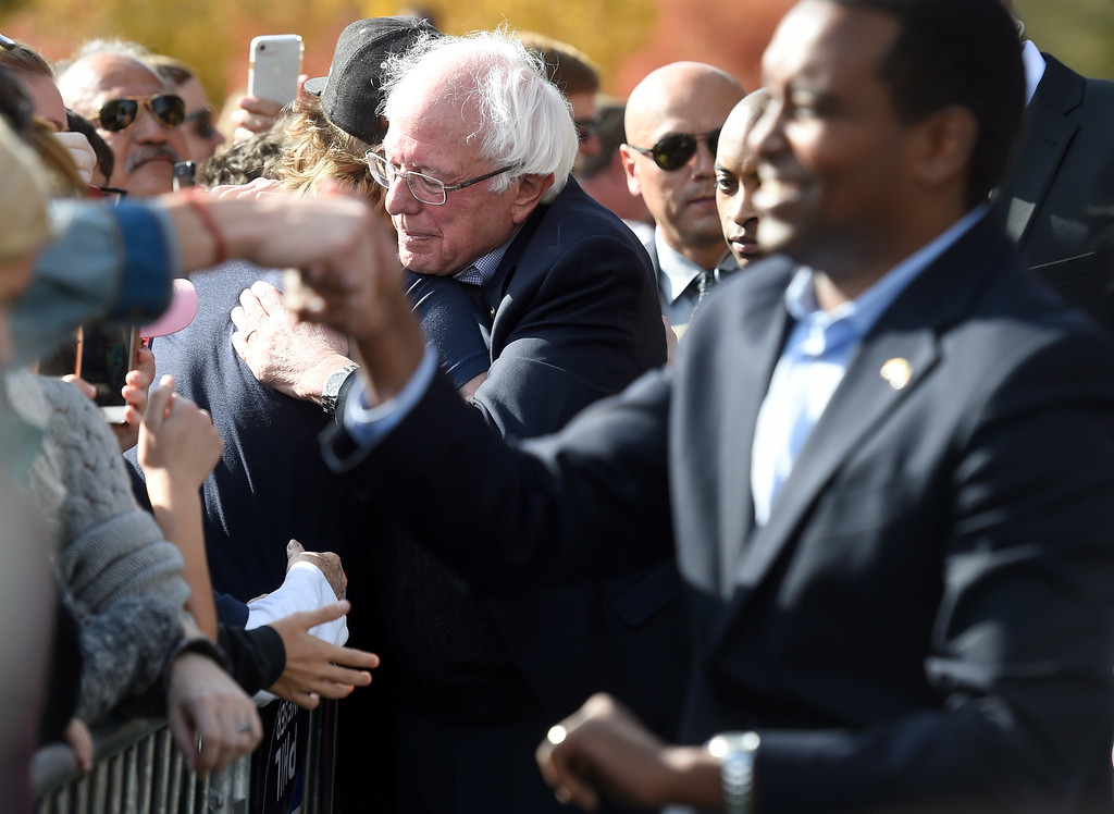 . BOULDER, CO - OCTOBER 24, 2018: Sen. Bernie Sanders hugs a supporter during a Democratic rally with U.S. Rep. Jared Polis and Joe Neguse, at right, on Wednesday at the University of Colorado in Boulder. For more photos of the rally go to dailycamera.com (Photo by Jeremy Papasso/Staff Photographer)