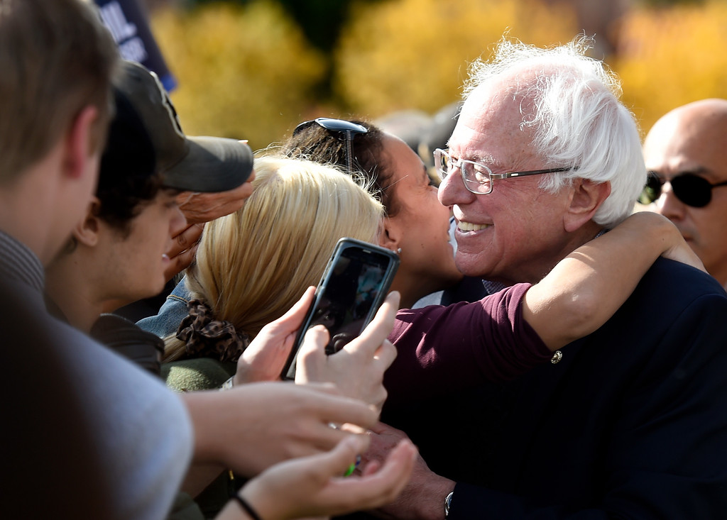 . BOULDER, CO - OCTOBER 24, 2018: Sen. Bernie Sanders hugs a supporter during a Democratic rally with U.S. Rep. Jared Polis and Joe Neguse on Wednesday at the University of Colorado in Boulder. For more photos of the rally go to dailycamera.com (Photo by Jeremy Papasso/Staff Photographer)