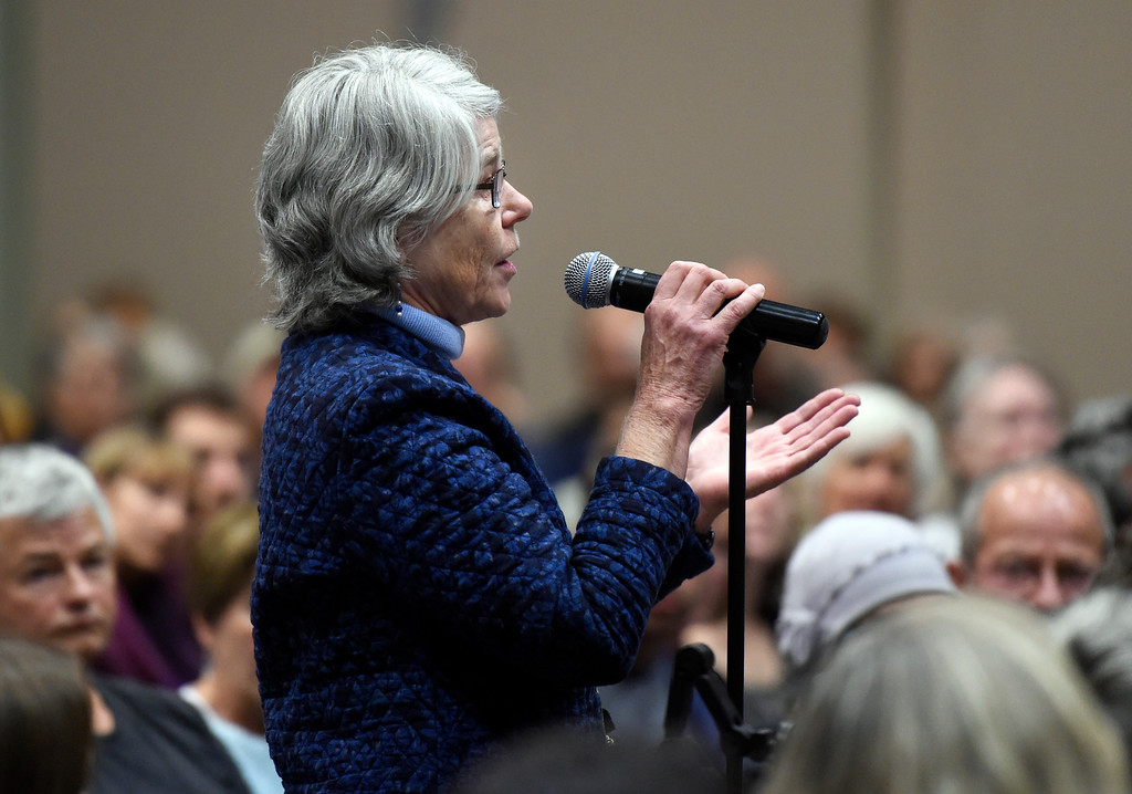 . Lyn Gullette, of Louisville, asks U.S. Sen. Michael Bennet a question about healthcare during a town hall meeting at UCAR on Friday in Boulder. For more photos and a video interview with Bennett go to www.dailycamera.com Jeremy Papasso/ Staff Photographer/ May 19, 2017
