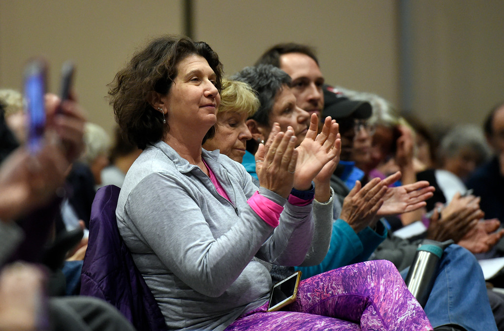 . Maxine Most, of Louisville, applauds after U.S. Sen. Michael Bennet answered a question from the crowd during a town hall meeting at UCAR on Friday in Boulder. For more photos and a video interview with Bennett go to www.dailycamera.com Jeremy Papasso/ Staff Photographer/ May 19, 2017