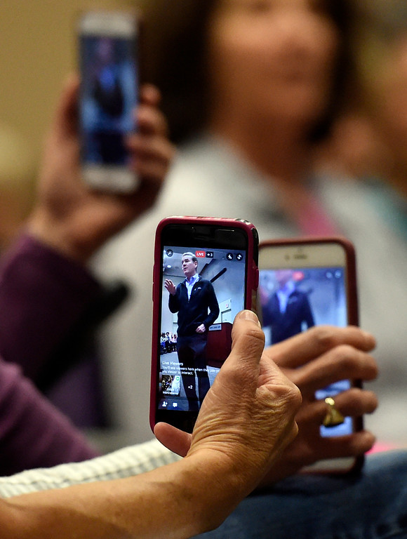 . People record video with their phones as U.S. Sen. Michael Bennet speaks to the crowd during a town hall meeting at UCAR on Friday in Boulder. For more photos and a video interview with Bennett go to www.dailycamera.com Jeremy Papasso/ Staff Photographer/ May 19, 2017