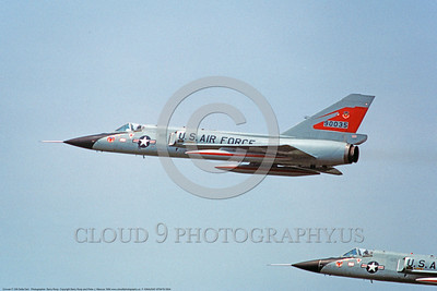 F-106AUSAF-87thFIS 0004 Two flying Convair F-106A Delta Darts USAF Cold War era Century Series fighter interceptors 90035 87th FIS RED BULLS 8-1984 military airplane picture by Barry Roop     DONEwt