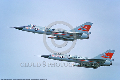 F-106AUSAF-87thFIS 0002 Two flying Convair F-106A Delta Darts USAF Cold War era fighter-interceptors 90035 and 90097 87th FIS RED BULLS 8-1984 military airplane picture by Barry Roop     DONEwt