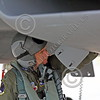 ACM 00154 A California ANG F-15 Eagle jet fighter pilot reaches for something in his F-15 Eagle jet fighter at Fresno ANG base 3-2015, portrait by Peter J Mancus