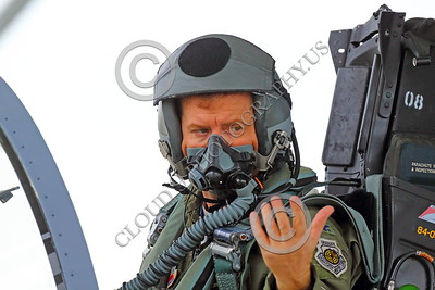 ACM 00052 A highly experienced California ANG F-15 Eagle jet figher pilot communicates with his crew chief during start up for a training mission, by Peter J Mancus