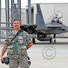 ACM 00130 Portrait of a California ANG senior non-commissioned officer with camera by a squadron F-15 Eagle jet fighter at Fresno ANG base 3-2015 military airplane picture by Peter J Mancus