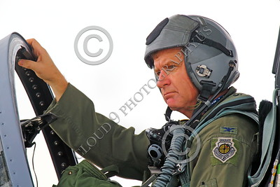 ACM 00106 A full colonel California ANG F-15 Eagle jet fighter pilot in his cockpit perhaps in deep thought, portrairt by Peter J Mancus