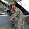 ACM 00131 A California ANG F-15 crew chief points to a Su-22 green star kill marking on his F-15 Eagle jet fighter at Fresno ANG base 3-2015 military airplane picture by Peter J Mancus