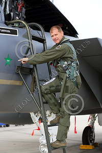 ACM 00038 A California ANG F-15 Eagle jet fighter pilot points to a SU-22 green star kill on the side of his F-15, 3-2015, military airplane picture by Peter J Mancus