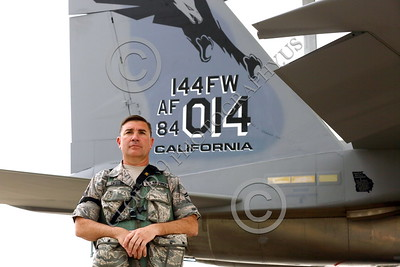 ACM 00109 A California ANG senior non-commissioned officer stands by the tail of his squadron's commanding officer's airplane at Fresno ANG base 3-2015 military airplane picture by Peter J Mancus