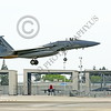 F-15ANG 00082 A McDonnell Douglas F-15 Eagle jet fighter California ANG 80018 144 FW lands at Fresno ANG base in front of F-15s in the alert hangers 3-2015 military airplane picture by Peter J Mancus