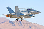 F-18USMC-VMFA(AW)-121 0040 A McDonnell Douglas F-18D Hornet USMC jet fighter 165530 VMFA(AW)-121 GREEN KNIGHTS commanding officer's airplane takes off in afterburner at Nellis AFB 2011 milit ...