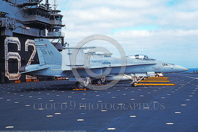 F-18USMC 00039 A static McDonnell Douglas F-18A Hornet USMC 163717 VMFAT-101 SHARPSHOOTERS on USS Independence 8-1989 military airplane picture by Rick Morgan  DONEwt