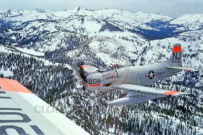 A-1USN-VA-122 0002  A flying Douglas A-1 Skyraider USN attack aircraft 135232 VA-122 FLYING EAGLES over the Sierra mountains circa 1960's official USN photograph via Talilhook Col  produced by Cloud 9 Photography     DONEwt