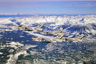 A-7USN-VA-215 002 Four Vought A-7B Corsair IIs USN attack jets, VA-215 BARN OWLS, USS Oriskany, NM code, flying over snow capped High Sierras, by Robert Lawson via Stephen W  D  Wolf collection    CCC_0285     Dt