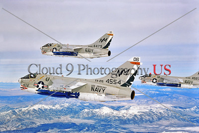A-7USN-VA-215 014 Three flying USN Vought A-7Bs, all with large blue practice bombs, VA-215 BARN OWLS USS Oriskany, NM tail code, 2-1975, by Robert Lawson, Stephen W  D  Wolf coll      BBB_9529     Dt