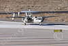 E-2USN 00277 A Grumman E-2 Hawkeye US Navy VAW-113 BLACK EAGLES USS Ronald Reagan taxis at NAS Fallon 1-2015 military airplane picture by Peter J Mancus