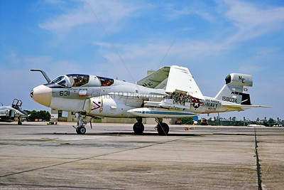 EA-6B-USN-VAQ-135 002 A static Grumman EA-6B Prowler, USN carrier based jammer, 158034, VAQ-135 BLACK RAVENS, USS Ranger, NE tail code, 7-1975 North Island, military airplane picture by Robert L  Lawson, via Stephen W  D  Wolf coll   CCC_3039  Dt