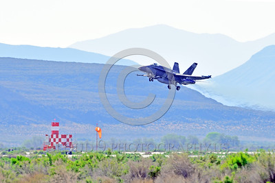 F-18A-USN-VFA-204 0008 A McDonnell Douglas F-18A USN VFA-204 RIVER RATTLERS jet fighter rotates its undercarriage after take-off at NAS Fallon 4-2016 ahed of one Boeing F-18 Super Hornet military airplane picture by Peter J  Mancus