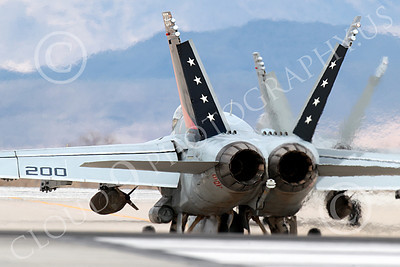 Boeing F-18C-USN 00241 A Boeing F-18C Hornet USN with two large bombs VFA-81 SUNLINERS taxis at NAS Fallon 3-2013 airplane picture by Peter J Mancus