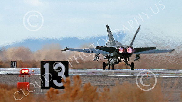 AB-F-18USN-L 00081 A Boeing F-18C Hornet USN VFA-94 MIGHTY SHRIKES takes off NAS Fallon 3-2013 military airplane picture by Peter J Mancus