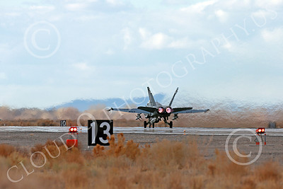 AB-F-18USN-L 00051 A Boeing F-18C Hornet USN VFA-94 MIGHTY SHRIKES takes off NAS Fallon 3-2013 military airplane picture by Peter J Mancus