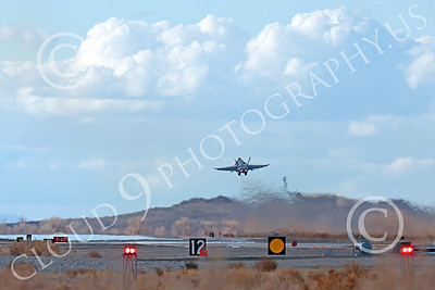 AB-F-18USN-L 00082 A Boeing F-18C Hornet USN VFA-94 MIGHTY SHRIKES takes off NAS Fallon 3-2013 military airplane picture by Peter J Mancus