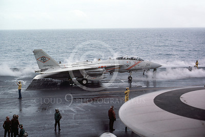 F-14USN 00947 A Grumman F-14 Tomcat USN 159447 VF-102 DIAMONDBACKS taxis on USS America 6-1983, by Steve Daniels