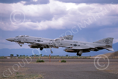 F-4USN 00008 Two McDonnell Douglas F-4J Phantom IIs US Navy 155766 155746 VF-102 DIAMONDBACKS with bombs USS Independence NAS Fallon May 1980 military airplane picture by Michael Grove, Sr