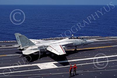F-14USN 00959 A Grumman F-14 Tomcat USN VF-103 SLUGGERS taxis on USS Saratoga 6-1985, by