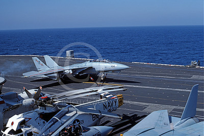 F-14USN 00861 A Grumman F-14 Tomcat USN VF-74 BEDEVILERS lands on USS Saratoga 11-1984, by Paul Balliston
