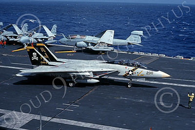 F-14USN 00865 A Grumman F-14 Tomcat USN VF-84 JOLLY ROGERS taxis on the USS Abraham Lincoln 1-1990, by Rick Morgan