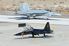 F-5USN 00205 A black Northrop F-5B Freedom Fighter jet fighter USN 761580 VFC-13 SAINTS taxis at NAS Fallon 1-2015 military airplane picture by Peter J Mancus