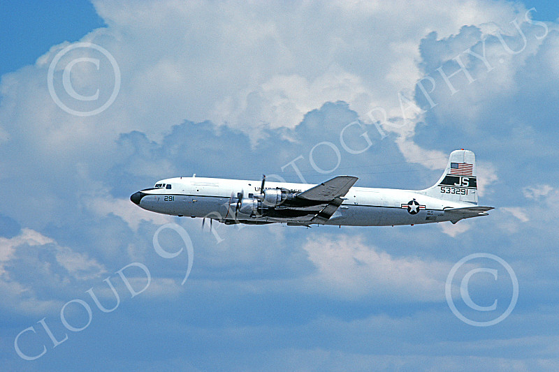C-118USN 00022 A flying Douglas C-118B Liftmaster USN 533291 VR-54 REVELERS JS code 6-1980 military airplane picture by Ron McNeil
