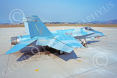 McDonnell Douglas F-18A-USN 00037 A static McDonnell Douglas F-18A Hornet USN VX-4 THE EVALUATORS NAS Pt Mugu 10-1985 military airplane picture by Charles Combs