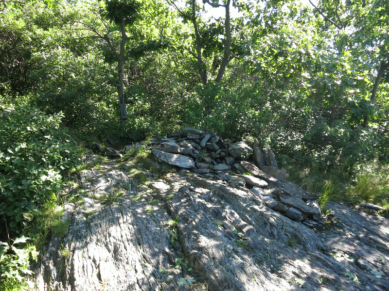 The Connecticut highpoint is located on the hillside and is marked by a cairn along side the trail.