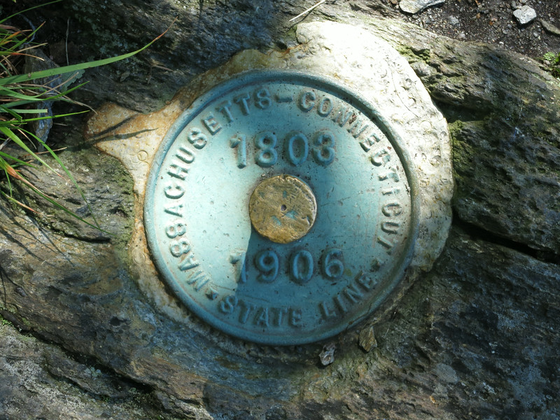 State line marker near the cairn.