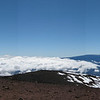 Panoramic from the summit looking south with Mauna Loa in the distance and Pu'uhaukea crater at the near right.