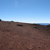 Summit with snow capped Mauna Loa in the background.