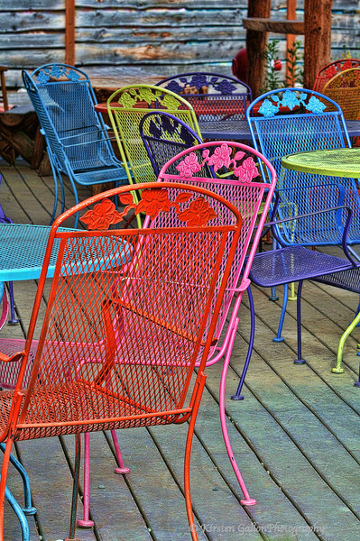 Colorful chairs on the patio of a restaurant in Talkeetna.