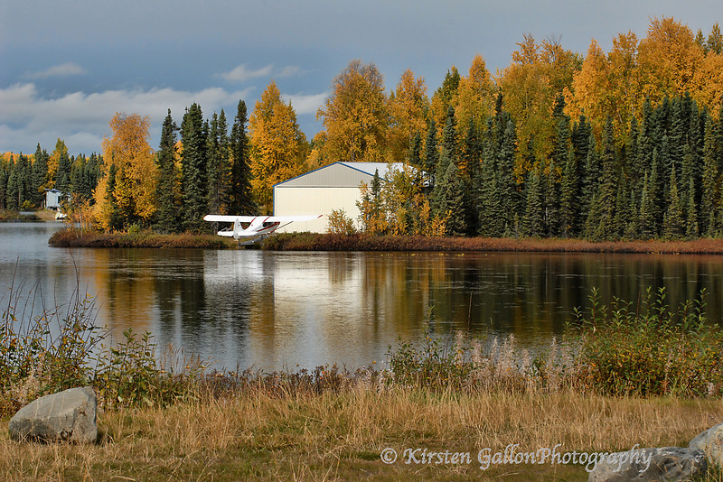A small lake outside of Anchorage where a few people have homes and hangers.  Traveling by plane is a major mode of transportation in Alaska as a lot of places you cannot get to by car.