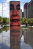 Crown Fountain.  Millennium Park.  Designed by conceptual artist Jaume Plensa.  There are actually two of these brick walls that double as fountains and they face each other.  Built with LCD brick panels, a face appears on both every few minutes.