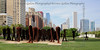 This set of sculptures is titled Agora.  Designed by artist Magdalena Abakanowicz.  Located in the south part of Grant Park.
